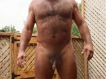 Hairy Bearded Daddy Naked and Enjoying the Rain Outdoors