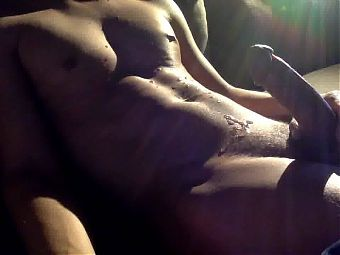 Horny young boy cums over his body
